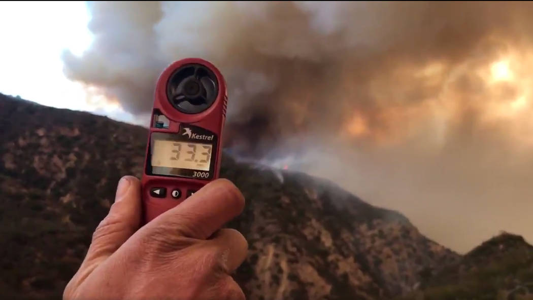 A wind speed indicator held by a U.S. Forest Service fire fighter on Gibraltar Road at the W. Fork of Cold Spring Trail, shows just how fast and varied the speed of the wind is blowing down canyon ...