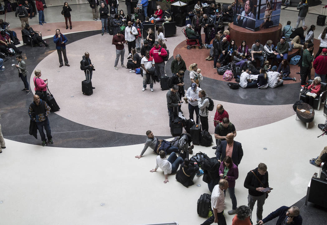 Long lines form at Hartsfield-Jackson International Airport after a power outage, Sunday, Dec. 17, 2017, in Atlanta. A sudden power outage at the Hartsfield-Jackson Atlanta International Airport o ...