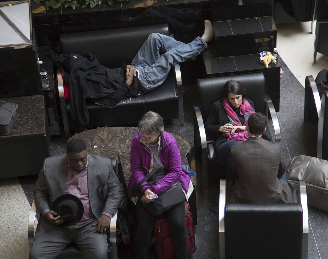 Passengers wait for the lights to come back on at Hartsfield-Jackson International Airport, Sunday, Dec. 17, 2017, in Atlanta. A sudden power outage at the Hartsfield-Jackson Atlanta International ...