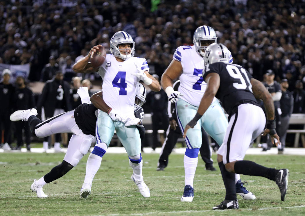 Oakland Raiders linebacker Nicholas Morrow (50) pressures Dallas Cowboys quarterback Dak Prescott (4) during the first half of a NFL game in Oakland, Calif., Sunday, Dec. 17, 2017. Heidi Fang Las  ...