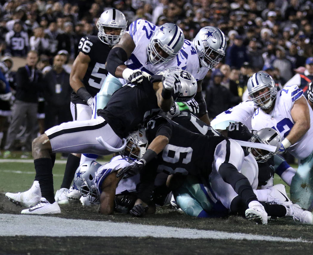 Dallas Cowboys running back Rod Smith (45) scores a 1-yard rushing touchdown against the Oakland Raiders during the first half of a NFL game in Oakland, Calif., Sunday, Dec. 17, 2017. Heidi Fang L ...