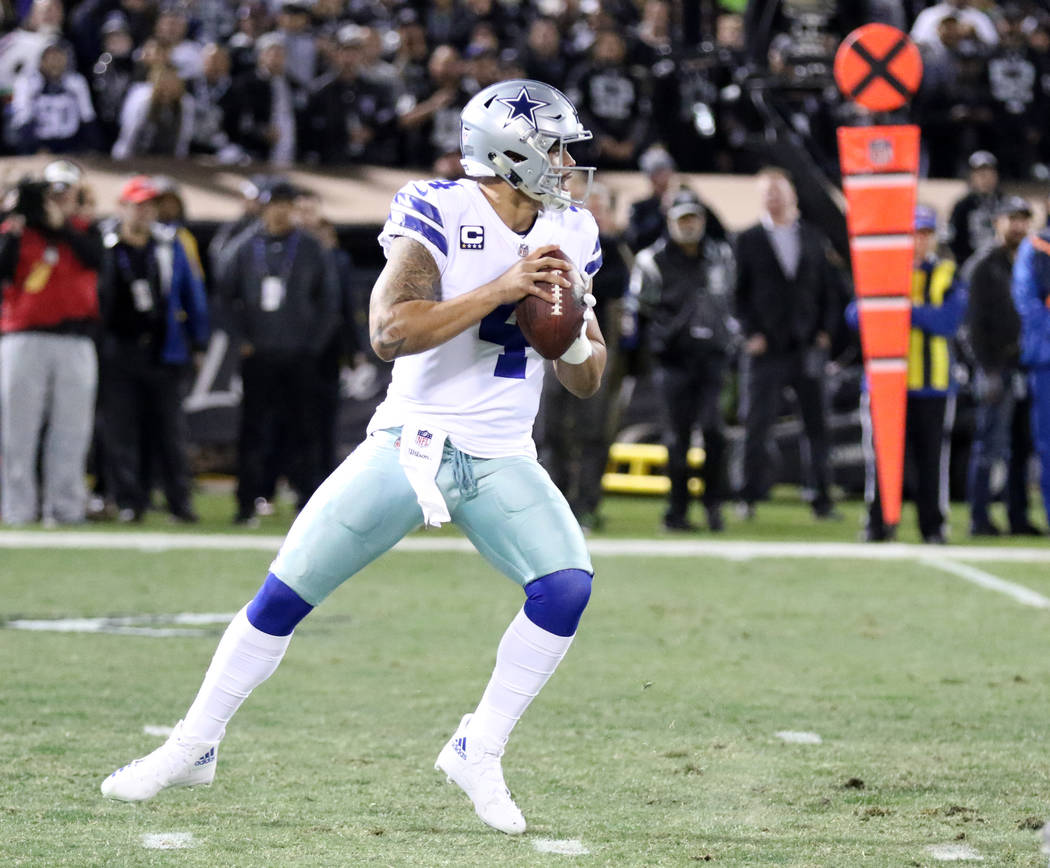 Dallas Cowboys quarterback Dak Prescott (4) drops back to pass against the Oakland Raiders during the first half of a NFL game in Oakland, Calif., Sunday, Dec. 17, 2017. Heidi Fang Las Vegas Revie ...