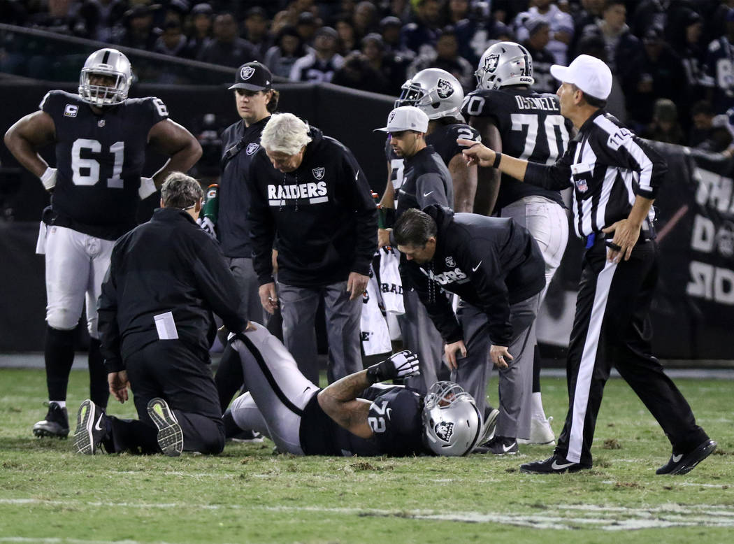 Oakland Raiders offensive tackle Donald Penn (72) is looked at by trainers after being hurt during the first half of a NFL game in Oakland, Calif., Sunday, Dec. 17, 2017. Heidi Fang Las Vegas Revi ...