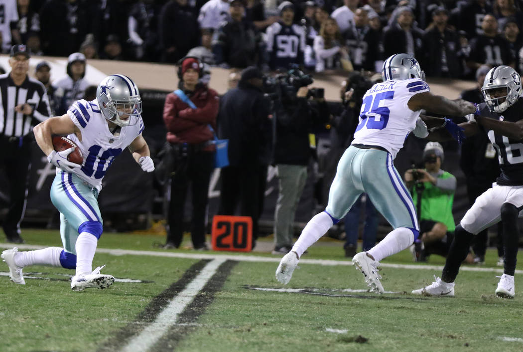 Dallas Cowboys wide receiver Ryan Switzer (10) runs with the ball on a punt return against the Oakland Raiders during the first half of a NFL game in Oakland, Calif., Sunday, Dec. 17, 2017. Heidi  ...