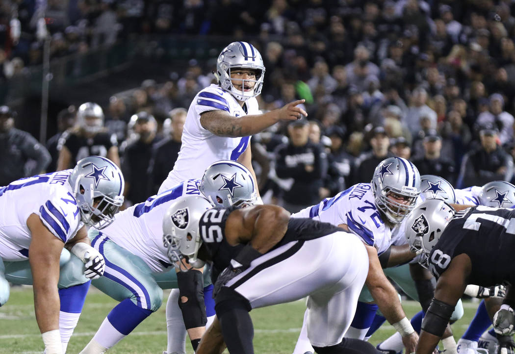 Dallas Cowboys quarterback Dak Prescott (4) calls an audible at the line of scrimmage during the first half of a NFL game against the Oakland Raiders in Oakland, Calif., Sunday, Dec. 17, 2017. Hei ...