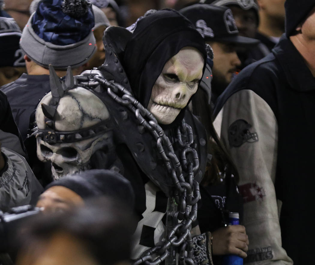 An Oakland Raiders fan watches the team play the Dallas Cowboys during the first half of a NFL game in Oakland, Calif., Sunday, Dec. 17, 2017. Heidi Fang Las Vegas Review-Journal @HeidiFang