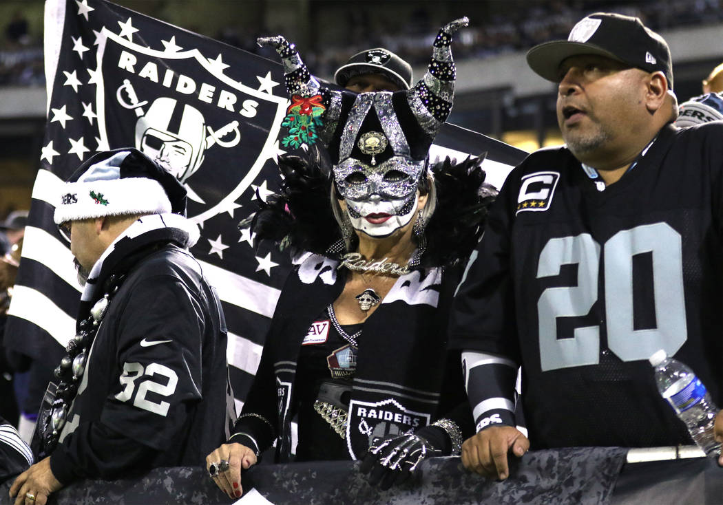 An Oakland Raiders fan with a holiday themed mask during the first half of a NFL game against the Dallas Cowboys in Oakland, Calif., Sunday, Dec. 17, 2017. Heidi Fang Las Vegas Review-Journal @Hei ...