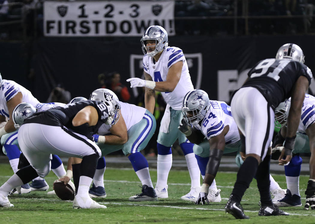 Dallas Cowboys quarterback Dak Prescott (4) calls a play at the line of scrimmage against the Oakland Raiders during the first half of a NFL game in Oakland, Calif., Sunday, Dec. 17, 2017. Heidi F ...