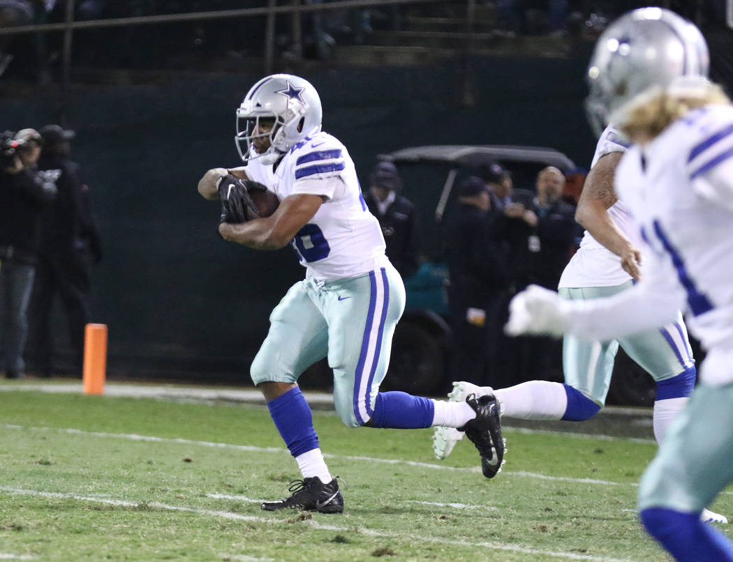 Dallas Cowboys running back Alfred Morris (46) runs with the football against the Oakland Raiders during the first half of a NFL game in Oakland, Calif., Sunday, Dec. 17, 2017. Heidi Fang Las Vega ...