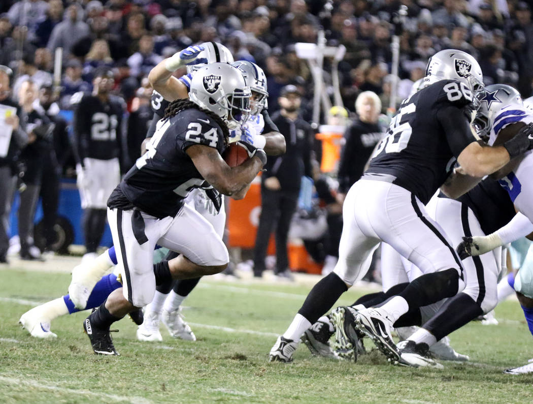 Oakland Raiders running back Marshawn Lynch (24) runs with the football against the Dallas Cowboys during the first half of a NFL game in Oakland, Calif., Sunday, Dec. 17, 2017. Heidi Fang Las Veg ...