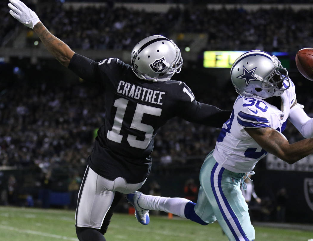 Dallas Cowboys cornerback Anthony Brown (30) deflects a pass intended for Oakland Raiders wide receiver Michael Crabtree (15) during the first half of a NFL game in Oakland, Calif., Sunday, Dec. 1 ...