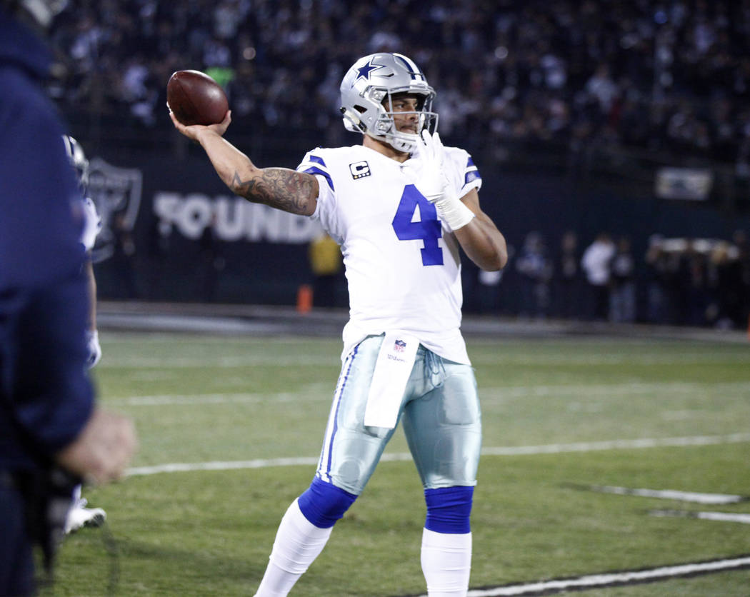 Dallas Cowboys quarterback Dak Prescott (4) warms up prior to the start of their NFL game against the Oakland Raiders in Oakland, Calif., Sunday, Dec. 17, 2017. Heidi Fang Las Vegas Review-Journal ...