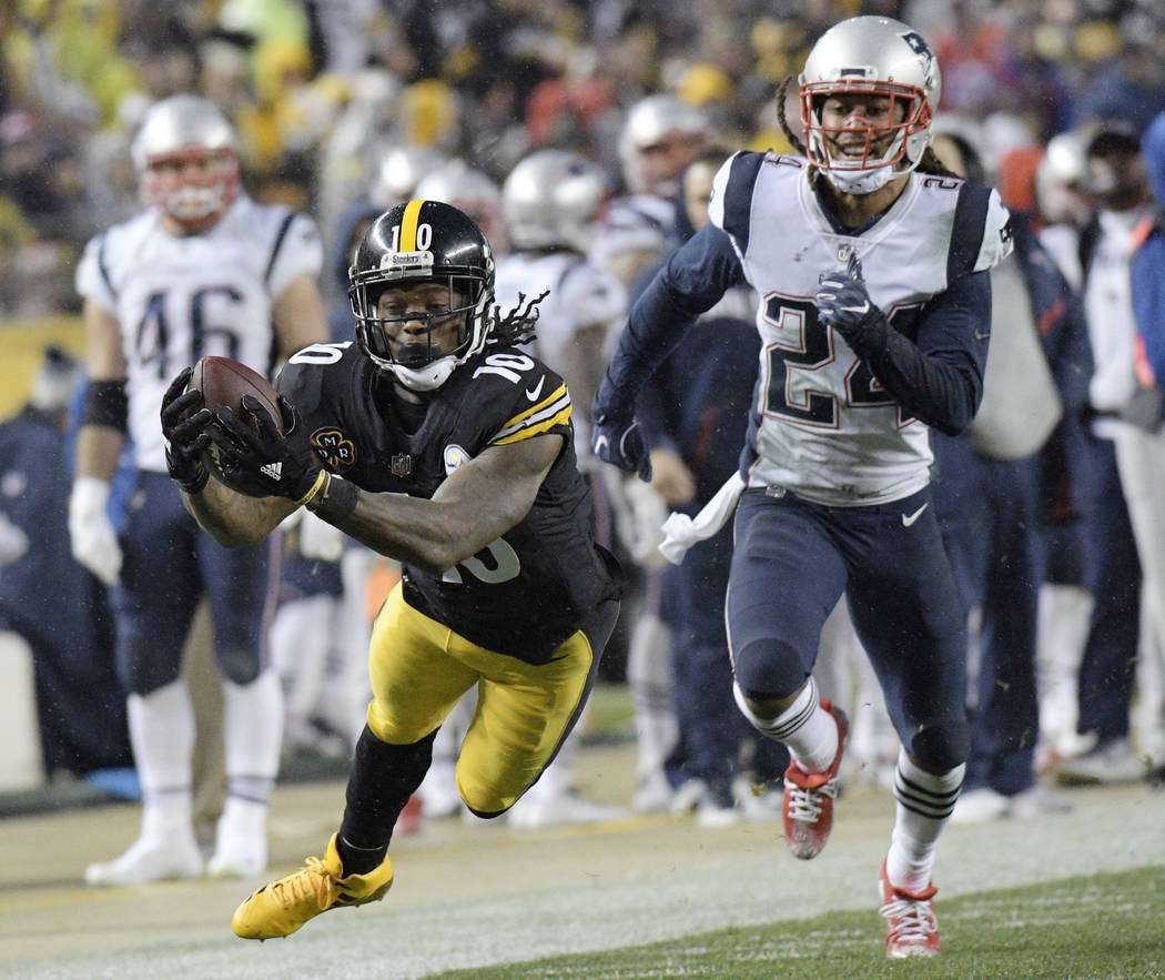 Pittsburgh Steelers wide receiver Martavis Bryant (10) dives to make a catch on a pass from quarterback Ben Roethlisberger with New England Patriots cornerback Stephon Gilmore (24) defending durin ...
