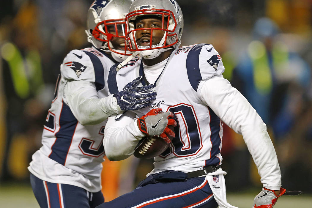 New England Patriots strong safety Duron Harmon (30) celebrates his interception in the end zone of a pass from Pittsburgh Steelers quarterback Ben Roethlisberger (7) during the second half of an  ...