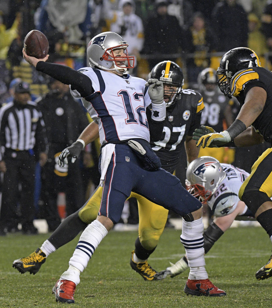 New England Patriots quarterback Tom Brady (12) passes under pressure from Pittsburgh Steelers defensive end Cameron Heyward, right, during the second half of an NFL football game in Pittsburgh, S ...