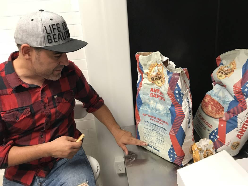 Vincent Rotolo enjoys a slice while he shows off his favorite flour. (Al Mancini/Las Vegas Review-Journal)