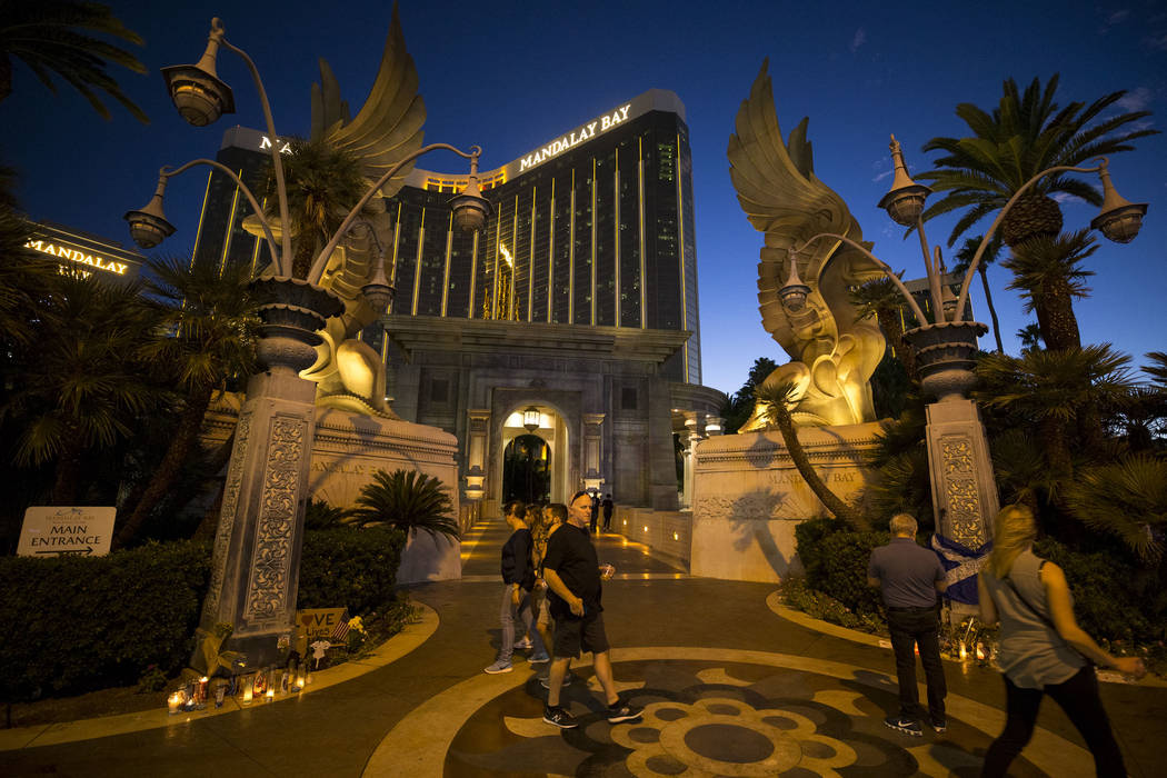 People visit a memorial for Route 91 shooting victims at the Mandalay Bay, Wednesday, Oct. 11, 2017. Richard Brian Las Vegas Review-Journal @vegasphotograph