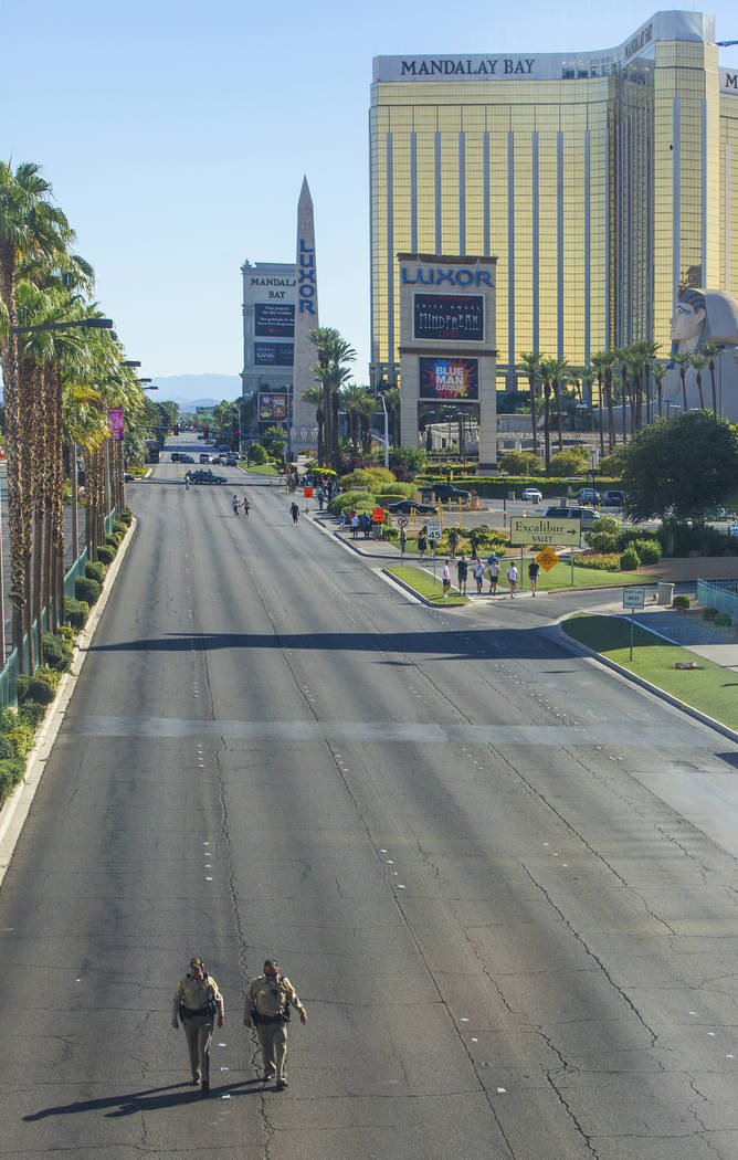 Las Vegas police keep the Strip south of Tropicana Avenue clear on Monday, October 2, 2017, in Las Vegas. A gunman in a Mandalay Bay hotel room shot into a crowd of thousands at an outdoor country ...