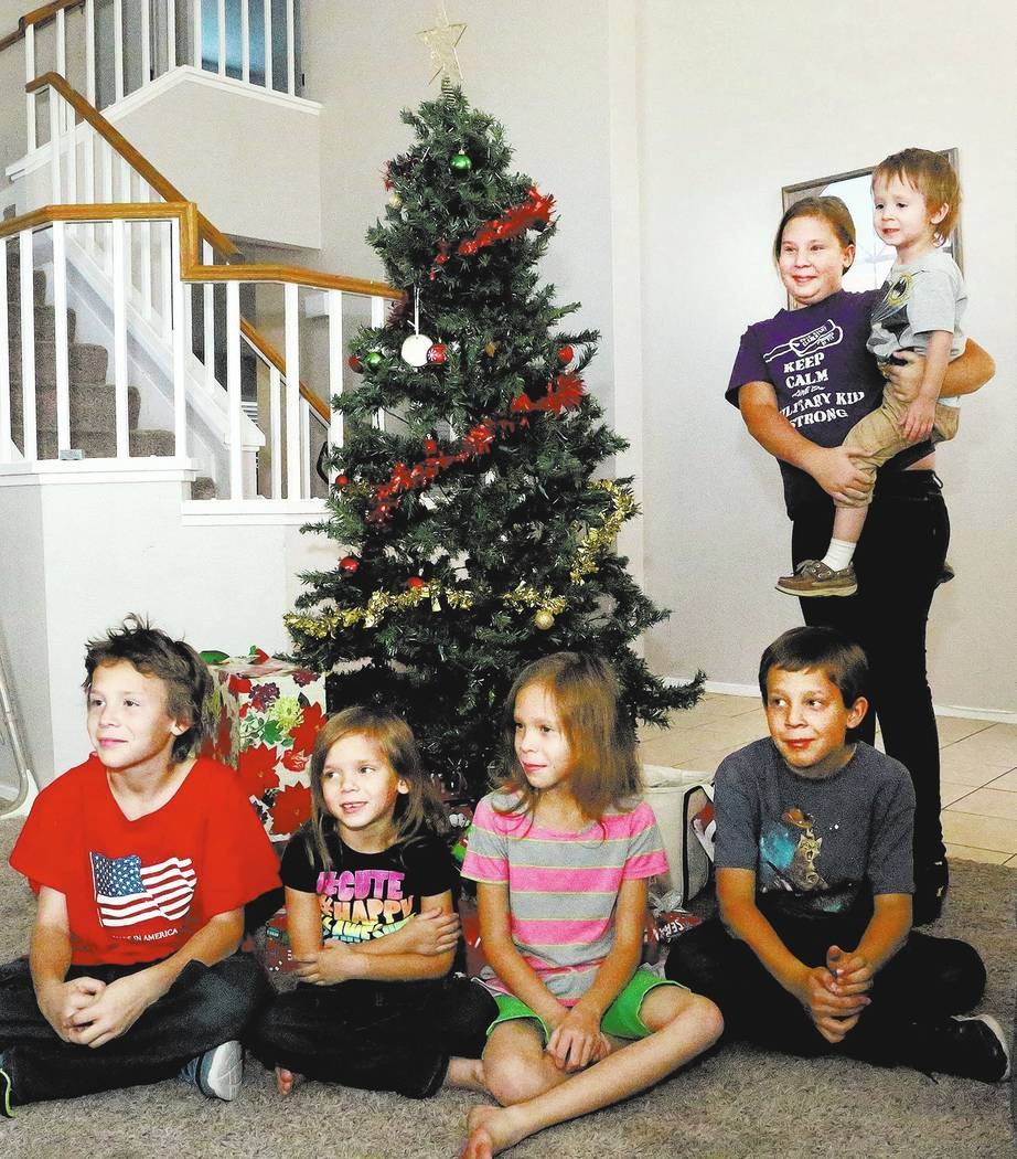 Six of the seven children of Army veteran Larry and Aaron Hamm, Clayton, 11, from left, Olivia, 6, Bethannie, 9, Larry, 10, Katie, 12, and Alexander, 3, arrive home from school to find that the Bo ...