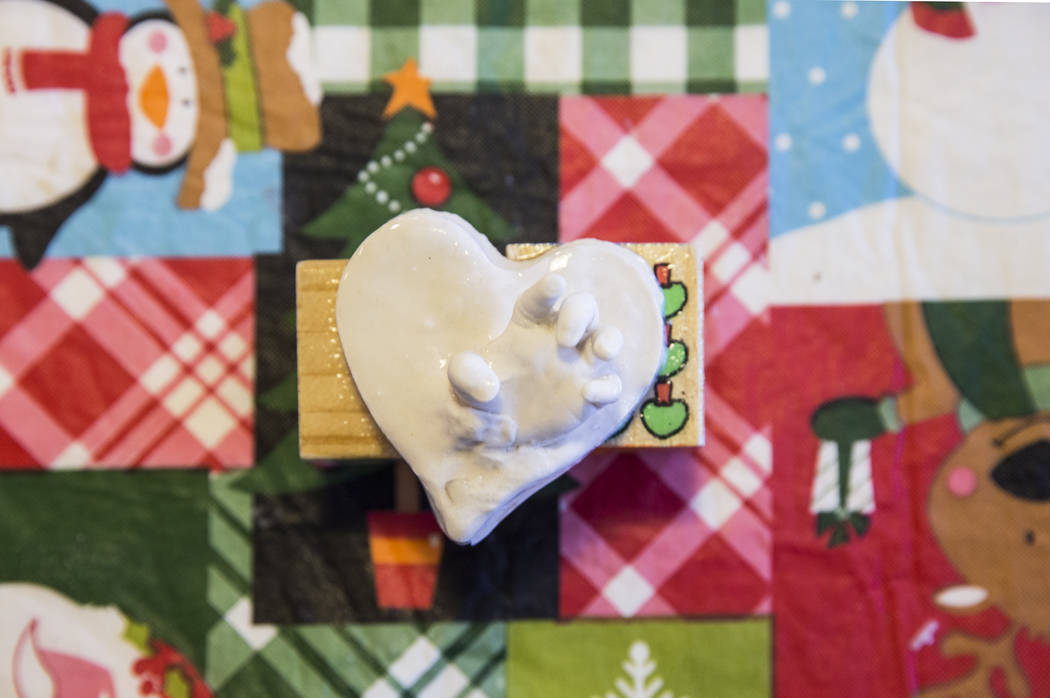 A plaster cast mounted on two building blocks of the Fuller's deceased twin daughter Amelie's hand on Thursday, Dec. 14, 2017, at the Fuller's home, in Henderson. The Fullers recently released the ...
