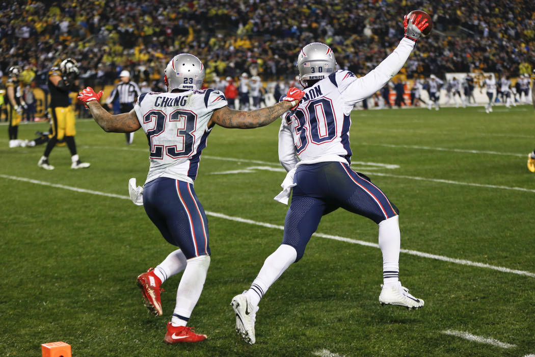 New England Patriots strong safety Duron Harmon (30) celebrates with strong safety Patrick Chung (23) after intercepting a pass in the end zone from Pittsburgh Steelers quarterback Ben Roethlisber ...