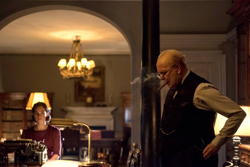 "Lily James stars as Elizabeth Layton and Gary Oldman as Winston Churchill in director Joe Wright's ""Darkest Hour,"" a Focus Features release. (Jack English / Focus Features)"