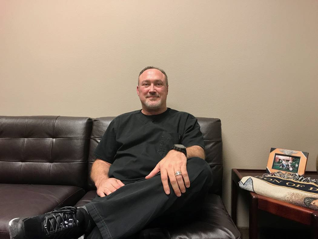 Michael Gunter, the team physician for the Las Vegas 51s and the Vegas Golden Knights, in his office Dec. 20. (Madelyn Reese/View) @MadelynGReese