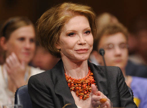 FILE - In this June 24, 2009 file photo, actress Mary Tyler Moore waits to testify on Capitol Hill in Washington before the Senate Homeland Security and Governmental Affairs Committee hearing on T ...