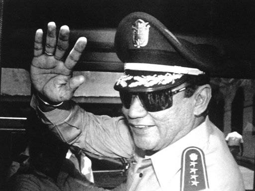 FILE - In this Aug. 31, 1989 file photo, Gen. Manuel Antonio Noriega waves to the press after a state council meeting at the presidential palace in Panama City, where the new president was announc ...