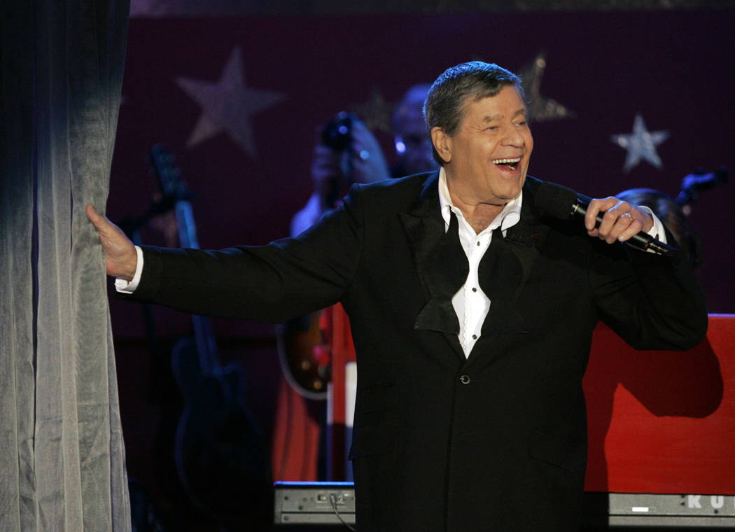 FILE - In this Sept. 5, 2005, file photo, longtime host Jerry Lewis performs during the Muscular Dystrophy Association telethon in Beverly Hills, Calif. Lewis, the comedian and director whose fund ...