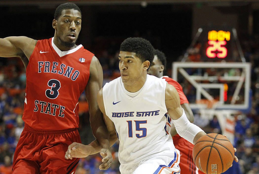 Boise State's Chandler Hutchison (15) moves the ball past Fresno State's Paul Watson (3) during the first half of an NCAA college basketball game in Boise, Idaho, Tuesday, Feb. 28, 2017. (AP Photo ...