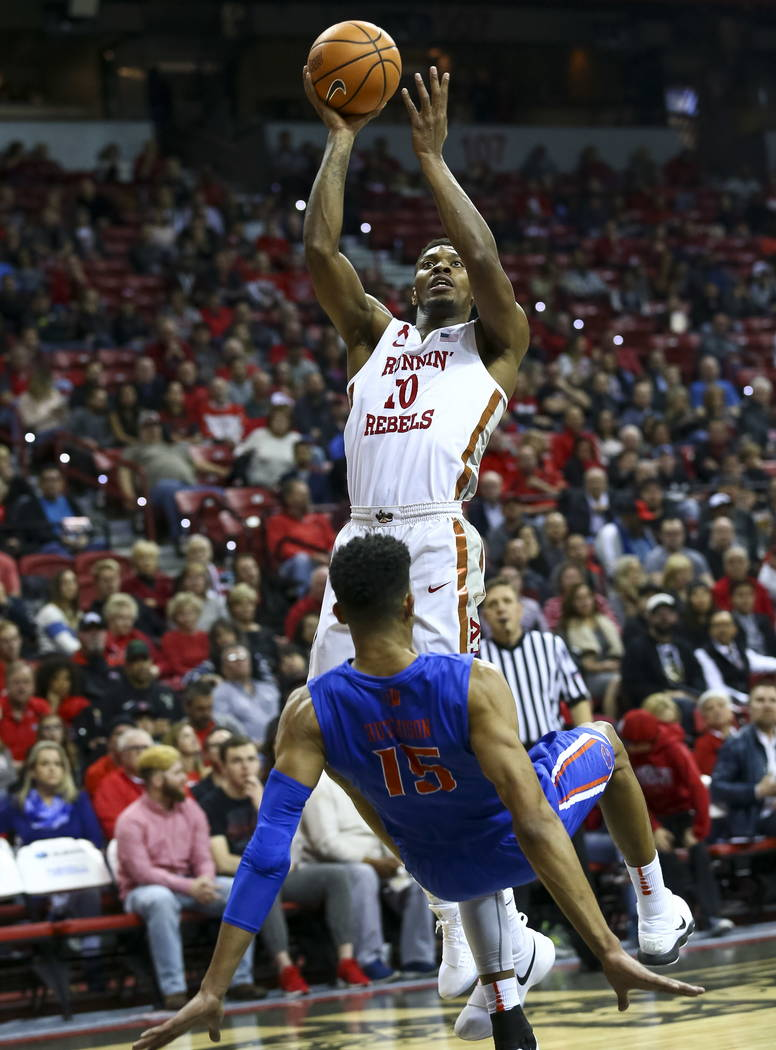 UNLV Rebels forward Shakur Juiston (10) shoots over Boise State Broncos guard Chandler Hutchison (15) during the first period of an NCAA college basketball game at the Thomas & Mack Center Sat ...