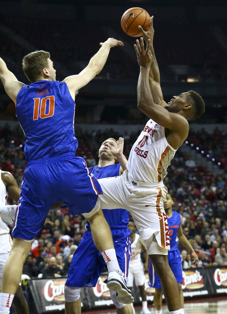Boise State Broncos center Robin Jorch (10) blocks UNLV Rebels forward Shakur Juiston (10) during the first period of an NCAA college basketball game at the Thomas & Mack Center Saturday, Dec. ...