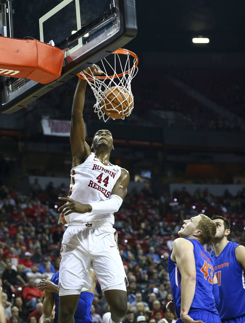 UNLV Rebels forward Brandon McCoy (44) dunks over Boise State Broncos forwards Christian Sengfelder and Zach Haney (11) during the first period of an NCAA college basketball game at the Thomas &am ...