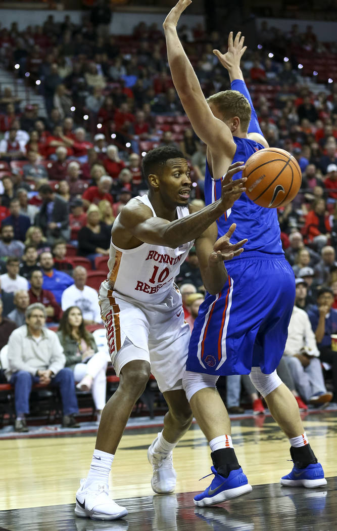 UNLV Rebels forward Shakur Juiston (10) passes past a Boise State Broncos defender during the first period of  an NCAA college basketball game at the Thomas & Mack Center Saturday, Dec. 30, 20 ...