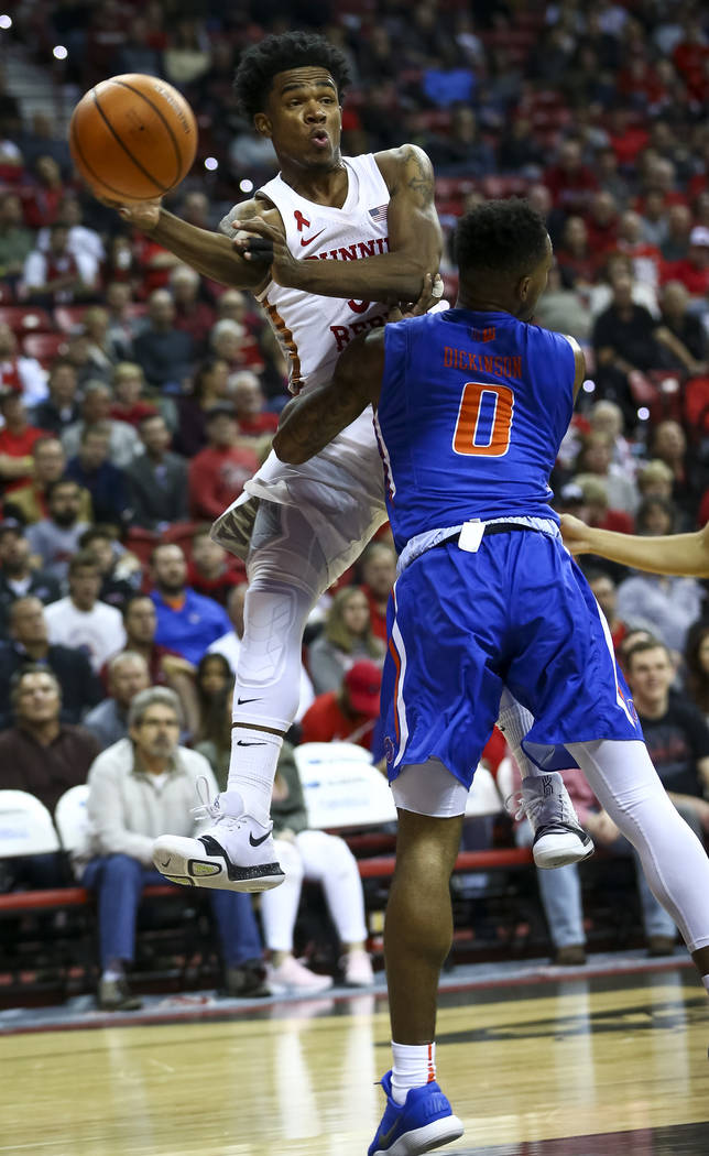 UNLV Rebels guard Jovan Mooring (30) passes past Boise State Broncos guard Marcus Dickinson (0) during the first period of an NCAA college basketball game at the Thomas & Mack Center Saturday, ...