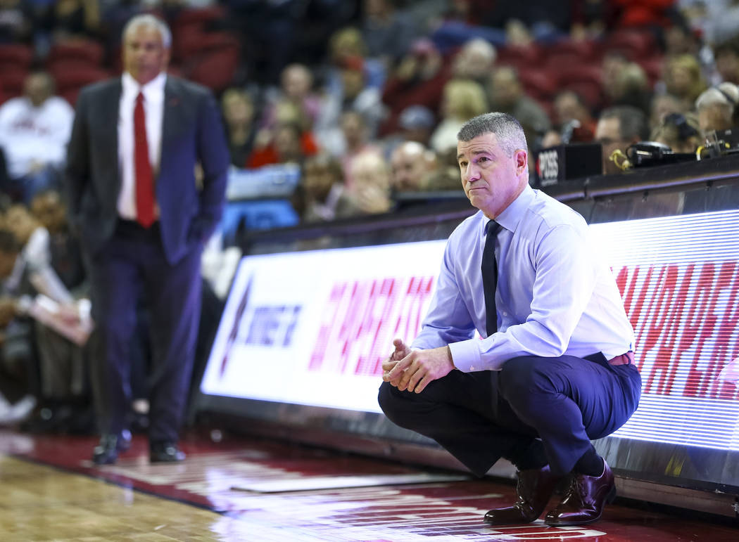 Boise State Broncos head coach Leon Rice, right, and UNLV Rebels head coach Marvin Menzies during the first period of an NCAA college basketball game at the Thomas & Mack Center Saturday, Dec. ...