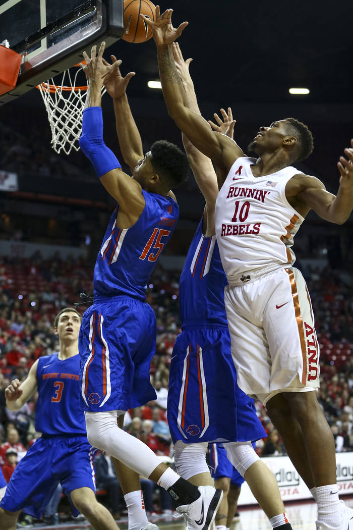 UNLV Rebels forward Shakur Juiston (10) and Boise State Broncos guard Chandler Hutchison (15) vie for the rebound during the first period of an NCAA college basketball game at the Thomas & Mac ...