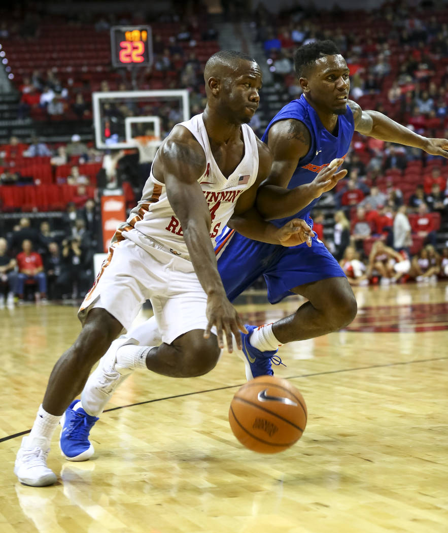 UNLV Rebels guard Jordan Johnson (24) is pressured by Boise State Broncos guard Marcus Dickinson (0) during the second period of an NCAA college basketball game at the Thomas & Mack Center Sat ...