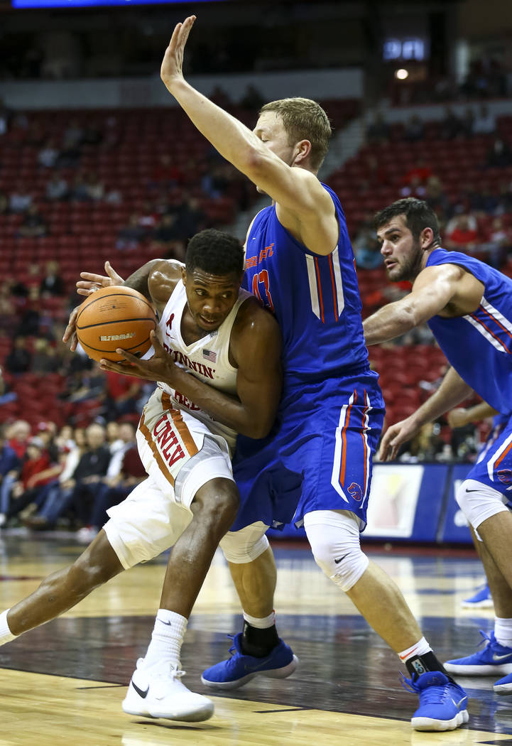 UNLV Rebels forward Shakur Juiston (10) drives the ball against Boise State Broncos forward Christian Sengfelder (43) during the second period of an NCAA college basketball game at the Thomas &amp ...