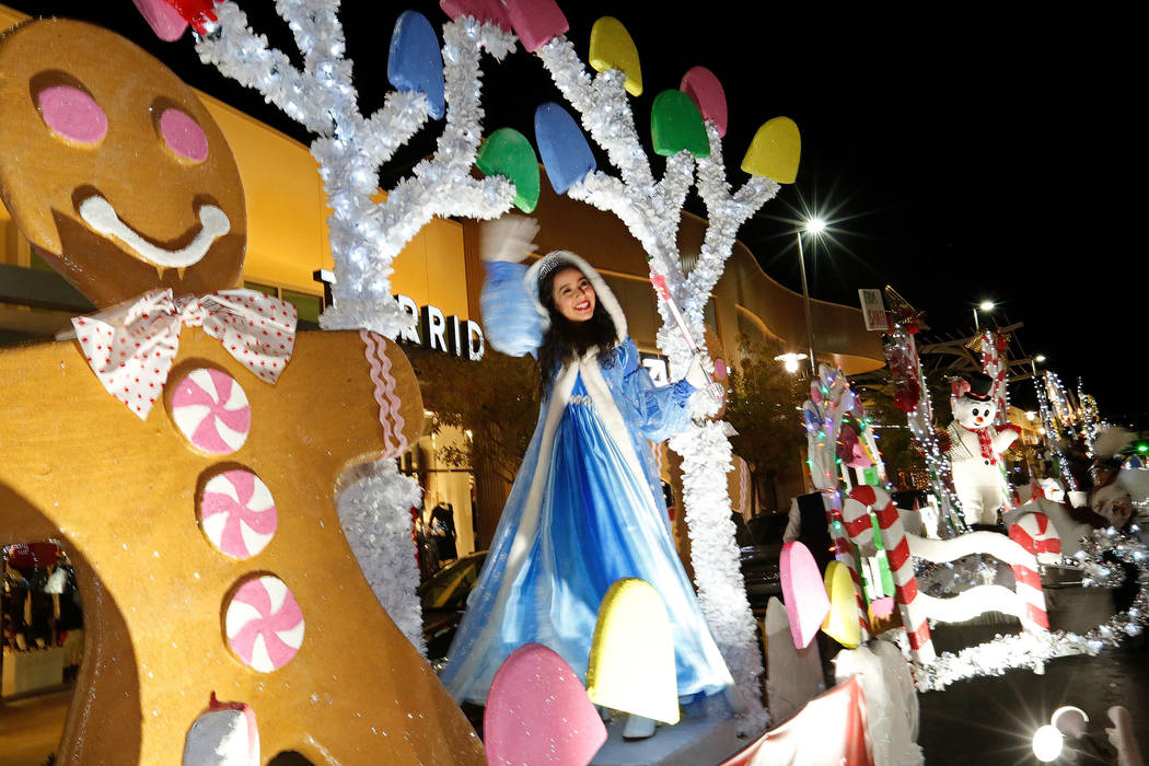 A girl waves from a float during the Downtown Summerlin holiday parade in Las Vegas, Monday, Dec. 18, 2017. Chitose Suzuki Las Vegas Review-Journal