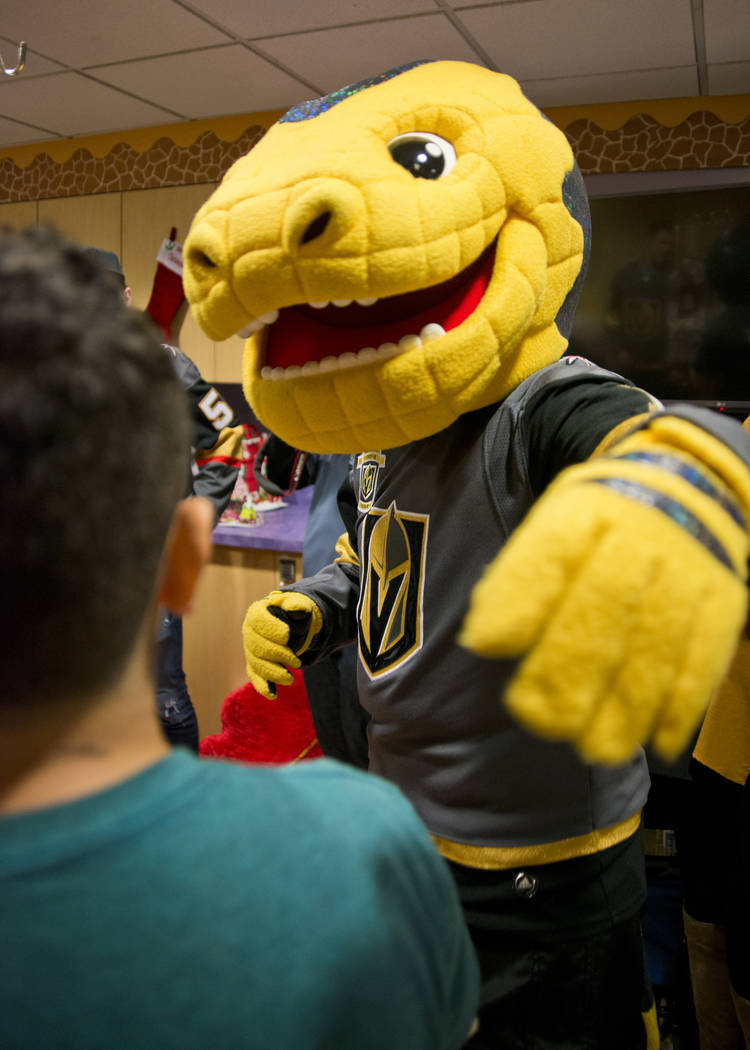 Vegas Golden Knights mascot Chance the Gila Monster greets Greco Alatorne during an event at the Children's Hospital of Nevada at University Medical Center in Las Vegas on Thursday, Dec. 21, 2017. ...