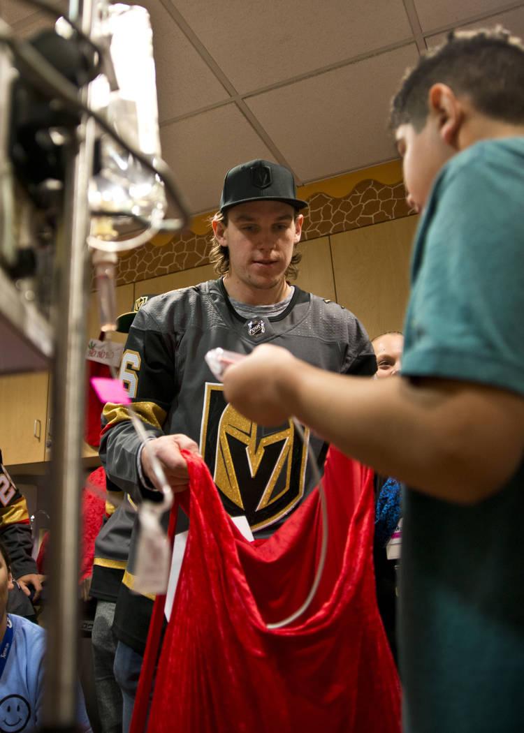 Vegas Golden Knights left wing Erik Haula greets Greco Alatorne during an event at the Children's Hospital of Nevada at University Medical Center in Las Vegas on Thursday, Dec. 21, 2017. Daniel Cl ...