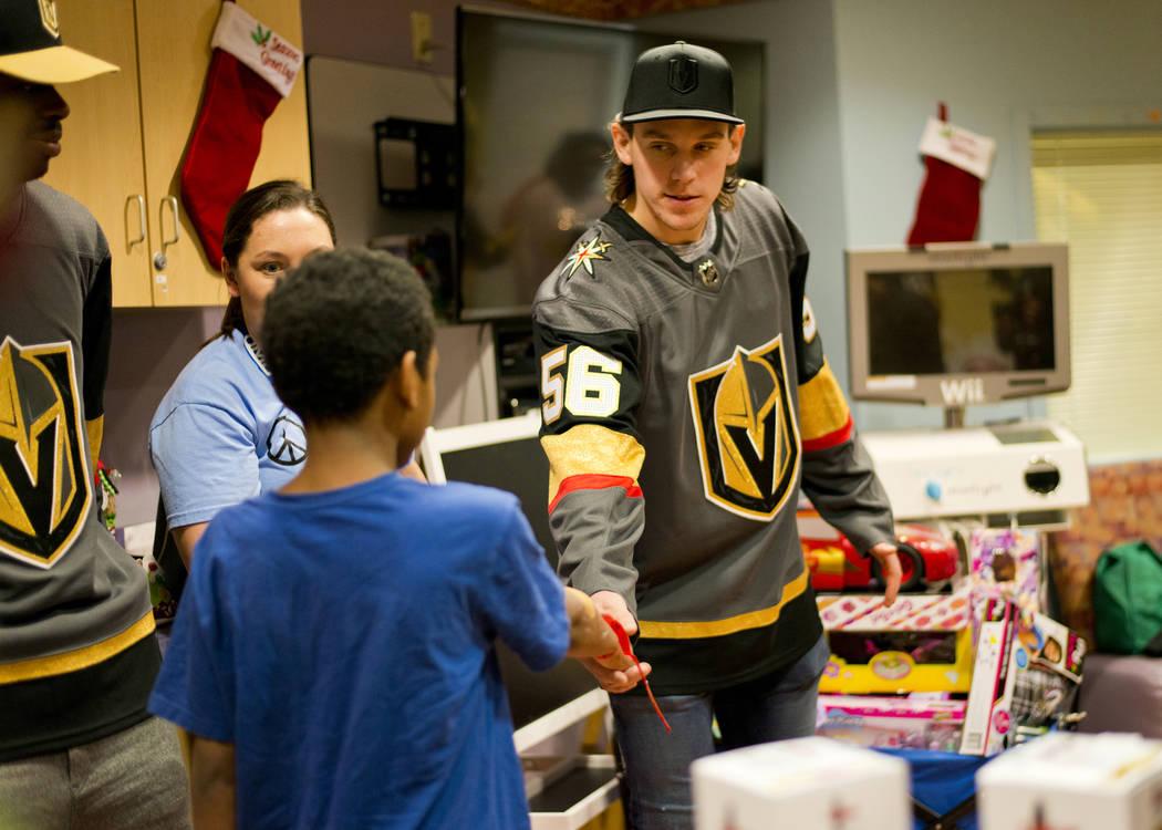Vegas Golden Knights left wing Erik Haula greets Deangylo Pollard during an event at the Children's Hospital of Nevada at University Medical Center in Las Vegas on Thursday, Dec. 21, 2017. Daniel  ...
