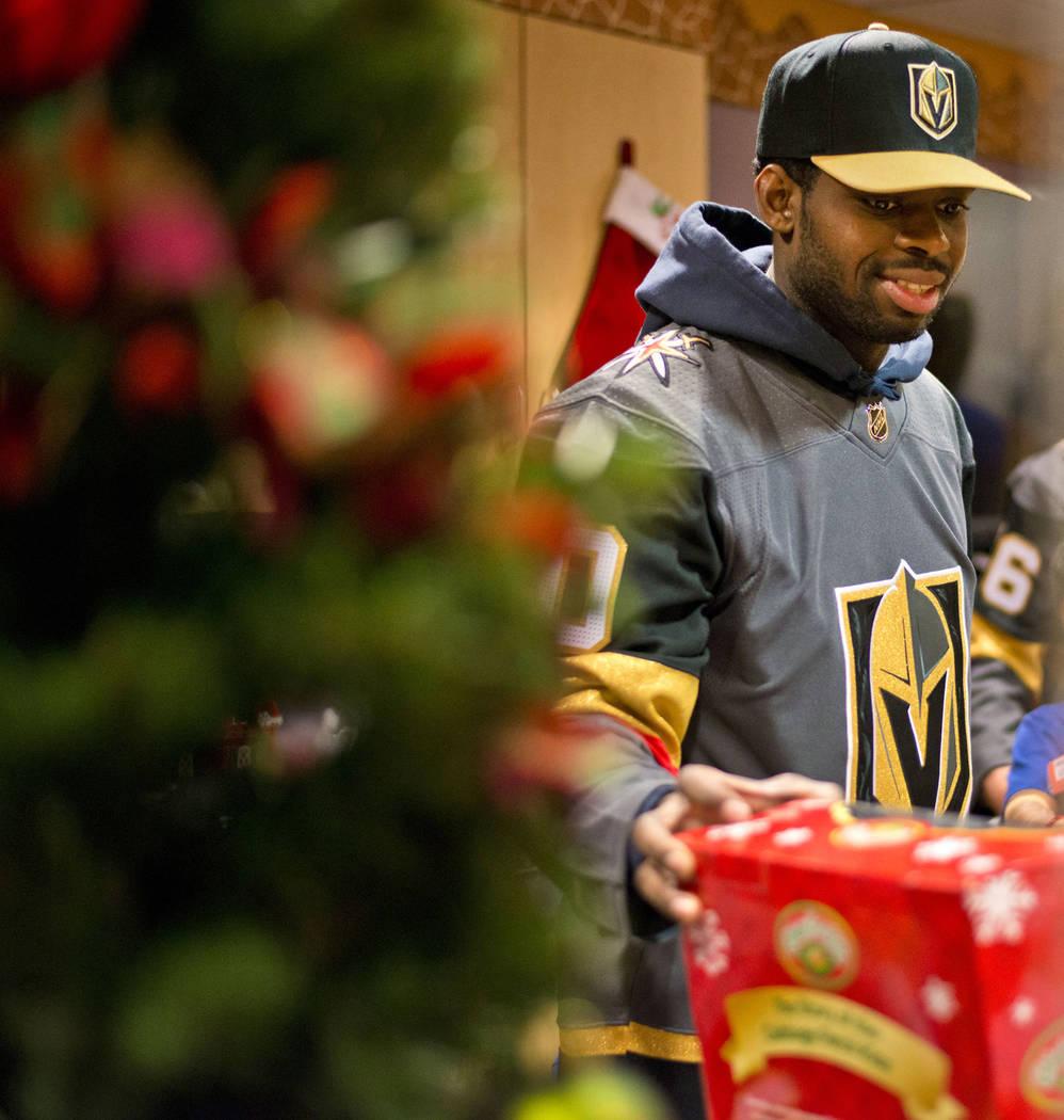Vegas Golden Knights goaltender Malcolm Subban organizes presents during an event at the Children's Hospital of Nevada at University Medical Center in Las Vegas on Thursday, Dec. 21, 2017. Daniel  ...