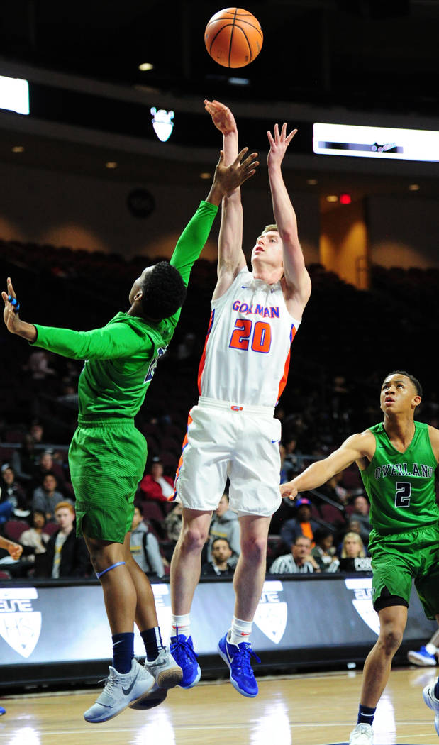 Bishop Gorman guard Noah Taitz (20) goes up for a shot in front of Overland (Colo.) forward Jalon Riceduring their prep basketball game at Orleans Arena in Las Vegas Wednesday, Dec. 20, 2017. Josh ...