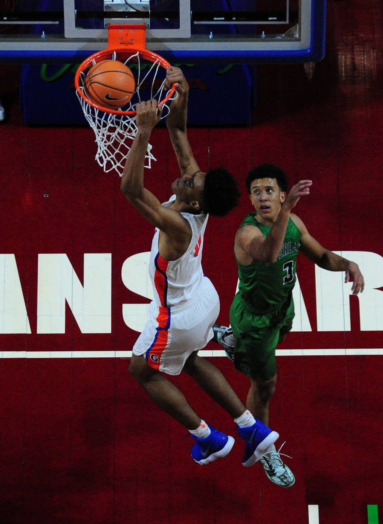 Bishop Gorman center Isaiah Cottrell dunks in front of Overland (Colo.) guard Tuscson Redding (3) during their prep basketball game at Orleans Arena in Las Vegas Wednesday, Dec. 20, 2017. Josh Hol ...