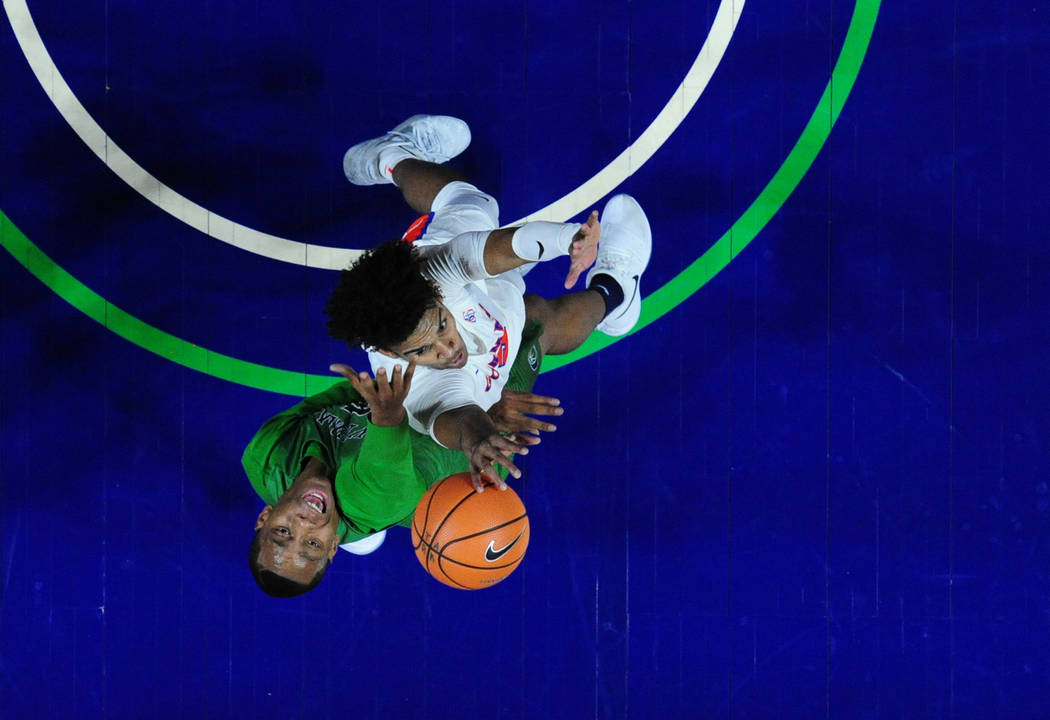 Bishop Gorman guard Jamal Bey blocks a shot by Overland (Colo.) forward Stephen Hayes (green)during their prep basketball game at Orleans Arena in Las Vegas Wednesday, Dec. 20, 2017. Josh Holmberg ...