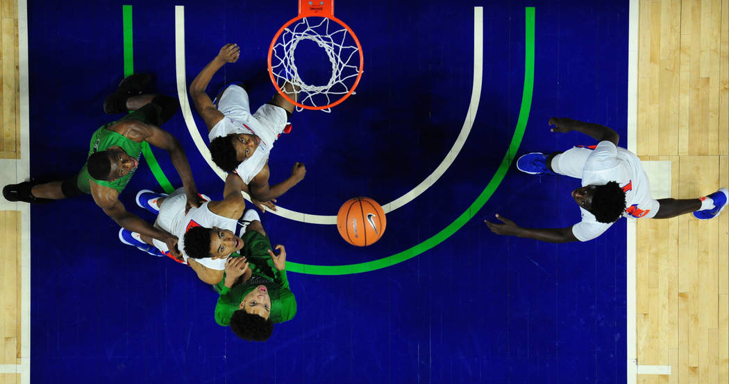 Bishop Gorman (white) and Overland (Colo.) players watch a shot during their prep basketball game against Bishop Gorman at Orleans Arena in Las Vegas Wednesday, Dec. 20, 2017. Josh Holmberg/Las Ve ...