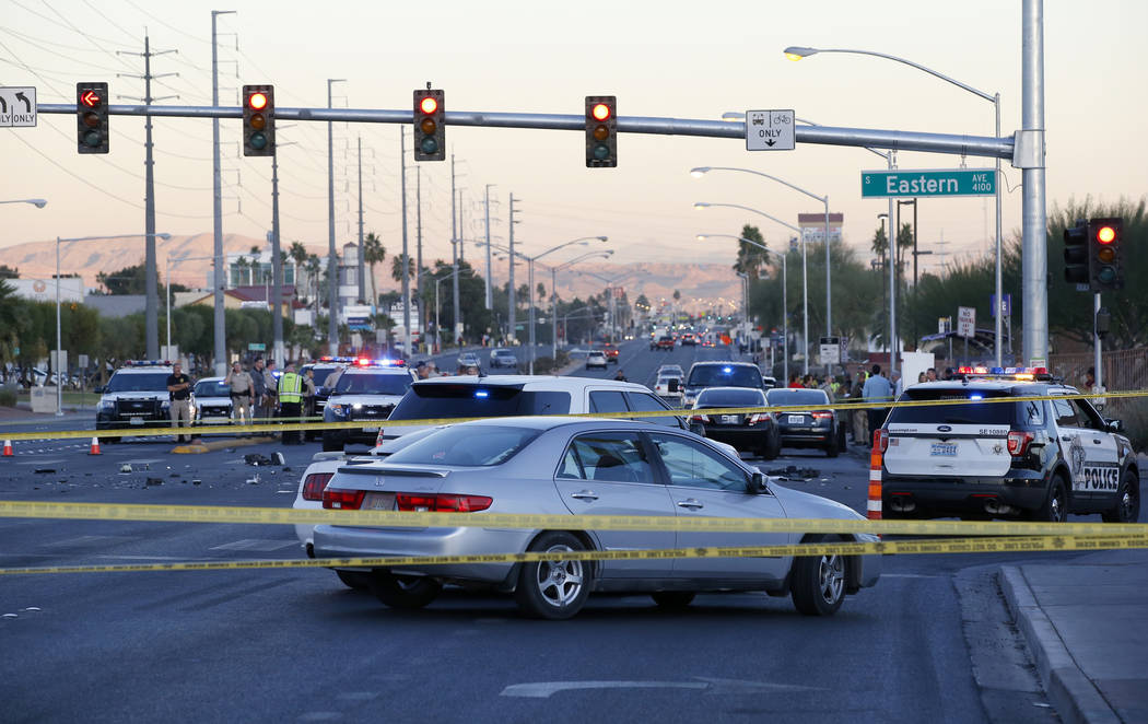 Las Vegas police in the intersection of Eastern Avenue and Flamingo Road where a multiple-vehicle crash left three people dead Wednesday, Dec. 13, 2017. Police said seven people were transported t ...